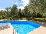 Private pool with terrace and garden area