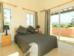 DDouble bedroom with A/C, en suite bathroom and access to the balcony