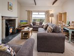 Wagtail Cottage - sitting room with log burner and 32' TV/DVD