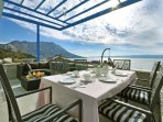 Outdoor dining and lounge area with amazing sea views