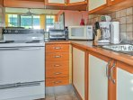 Prepare a meal in the well-equipped kitchen.