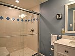 Enjoy freshening up in a pristine bathroom with a spacious shower.
