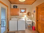 You'll love the convenience of the laundry room, with a full size washer and dryer, along with a utility sink.