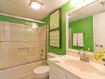 Hall bathroom with a tub/shower