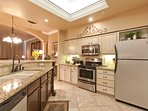 Kitchen area with updated appliances and view of the ocean.