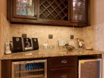 Wet Bar area with two mini refrigerators.