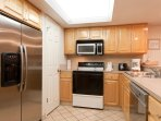 Kitchen is well equipped for all of your cooking needs with plenty of storage space in walk-in pantry