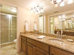 Master bathroom with a walk in shower