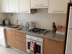 Kitchen with oven/hob fridge/freezer dishwasher/washing machine