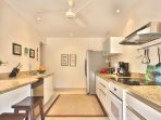 Kitchen with Granite Counter Tops and Laundry Room