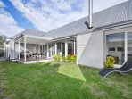 secure yard, covered deck, seating for 8 , BBQ and sunloungers