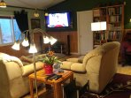 3 wall mounted TVs and Library of Table Top interesting and rare books