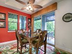 Tastefully decorated dining room leads to a wraparound lanai with BBQ.