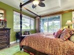 Master king canopy bed with pool, mountain, coast line and golf course views.