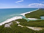 Clam Pass is a pristine natural environment with white sand and warm crystal clear ocean.
