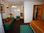 Bedroom #2 on basement level with window has Queen bed