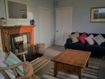 The lovely cosy sitting room is a perfect place to relax in after days out.