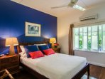 Master bedroom - Queen bed, air conditioned, ceiling fan, TV.