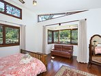 Master bedroom bay window looking out to the native bush.
