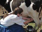Yes, we still milk by hand and yes, you can try!