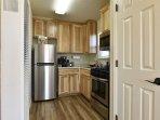 Brand new kitchen with modern appliances.