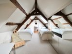 Mezzanine with 2 single beds and bath room with toilets