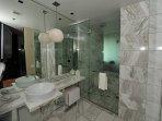 Large, Marble-tiled Bathroom