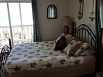 Oceanfront master suite with walk-out deck