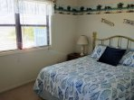 Spacious and light 3rd bedroom with queen bed and vaulted ceilings
