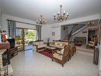 Living room with WiFi, satellite TV, DVD player and terrace access