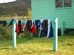 Wetsuits drying at the cottage