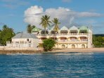 White Sands condo from the sea. Small house in front on the beach is now Hugo's restaurant