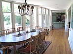 Our solid cherry dining table seats 10.  French doors access deck that extends entire width of house