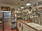 This home provides plenty of cooking utensils and dishware.