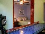 Moroccan Breakfast Bar with Break-through Opening Into Bedroom/Living Room
