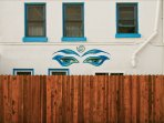 'Eyes' in the back of the building. 'May All Beings Be Happy and at Peace'