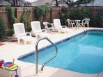 Large private swimming pool with 6-foot privacy fence