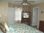 Master Bedroom with entertainment center -- TV, DVD/VCR, videos, books, games