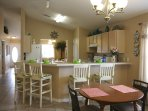 Game table in family room, breakfast bar, kitchen.  This home is very spacious!