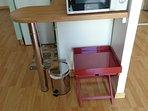 Kitchen corner: bin and a handy coffee table