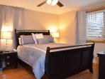 Large bedroom with second flat screen TV, hotel grade linens and generous closet/drawer space