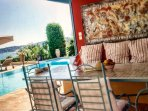 Swimming pool level terrace table and chairs