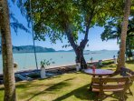 Another table in the garden, directly opening on the Chalong Bay