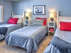 This bedroom with 3 twin-sized beds is ideal for families traveling with young kids.