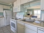 The kitchenette has all of the appliances you need to cook your favorite meals.