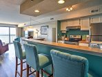 Dine at the table or this bar area.