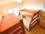 4th bedrm w/2 bunks. Bottom bunk on one side is a full size bed. Has a deck too!