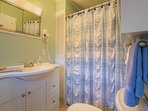 Walk in shower with two seats in Serenity Haven, also high elongated toilet.