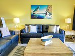 Nautical & bright living room to relax at after a beach day. Queen sleeper.