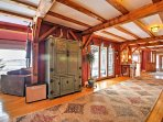 Post and beam construction, vibrant colors, and beautiful rugs lead you throughout the 3-story home.